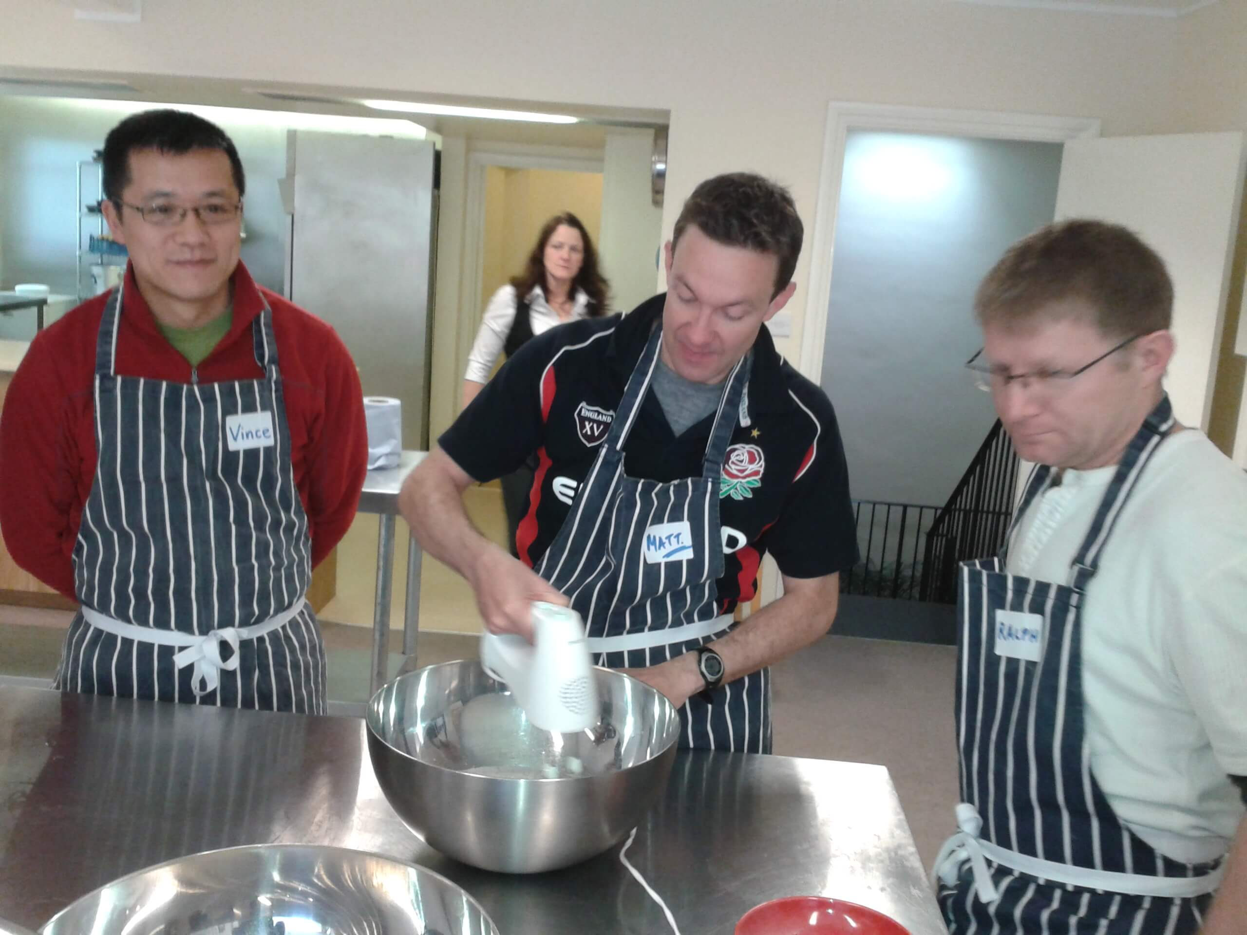 mixing chocolate torte during cooking class brighton