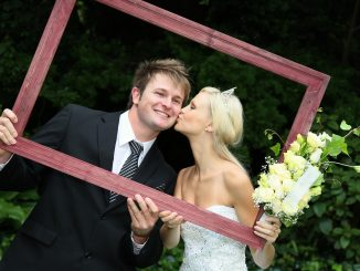bride and groom in a wooden frame