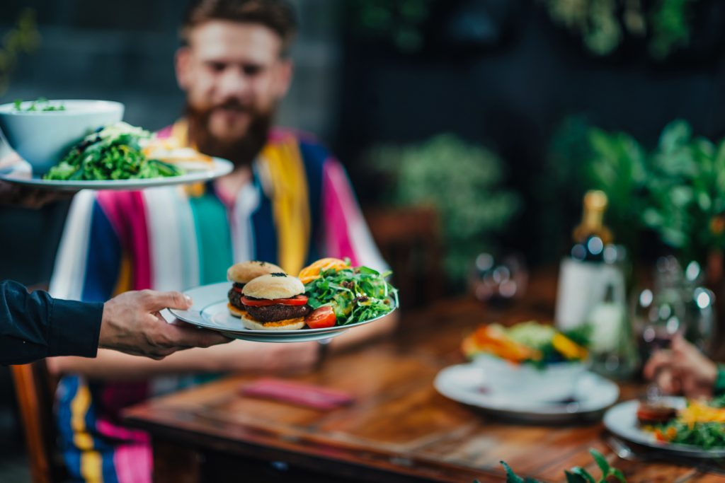 vegetarian burgers and salads being served